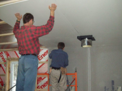 David and Jonathan dry walling the ceiling