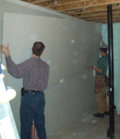 lifting drywalling into place